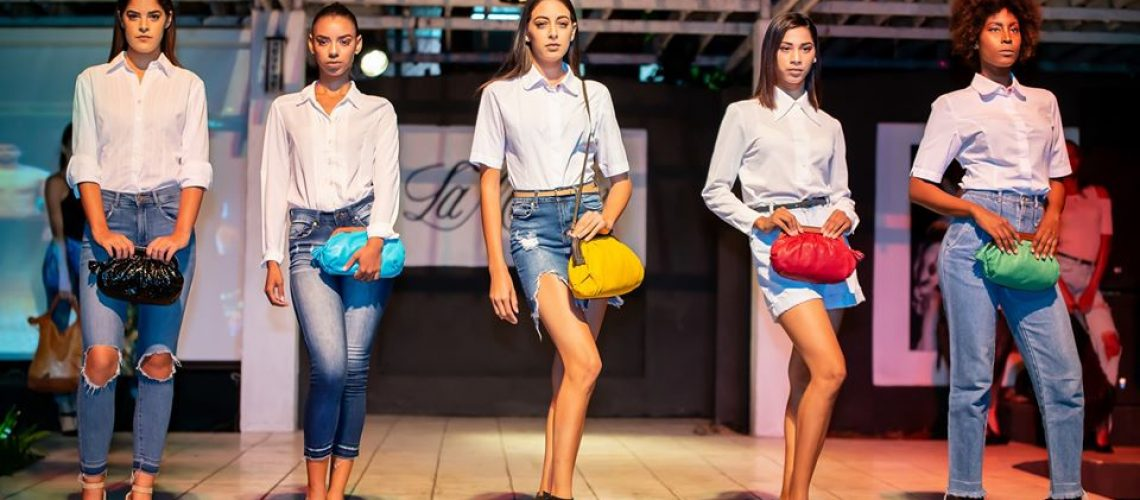 models holding bags